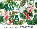 Stock vector tropical floral seamless vector pattern background with exotic flowers palm leaves jungle leaf 772437832