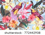 Stock vector tropical seamless vector pattern background with exotic flowers palm leaves jungle leaf hibiscus 772442938
