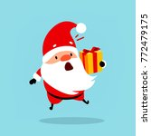 funny santa claus is holding a... | Shutterstock .eps vector #772479175