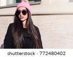 brunette on the street. urban... | Shutterstock . vector #772480402