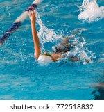boy on a swim in a sports pool   Shutterstock . vector #772518832
