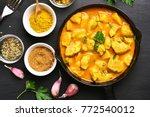 chicken curry in frying pan on... | Shutterstock . vector #772540012