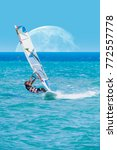 windsurfer playing in the waves ... | Shutterstock . vector #772557778