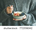 healthy winter breakfast. woman ... | Shutterstock . vector #772558342
