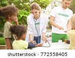 volunteer doctor measuring... | Shutterstock . vector #772558405