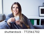 cheerful young woman drinking... | Shutterstock . vector #772561702