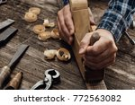 carpenter working in his... | Shutterstock . vector #772563082
