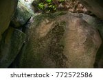 Rock Inside A Cave With Green...