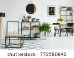 round mirror above shelf with... | Shutterstock . vector #772580842