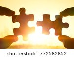 two hands trying to connect... | Shutterstock . vector #772582852