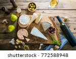 cheese on wood. types of cheese ...   Shutterstock . vector #772588948