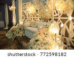 Small photo of Malay wedding dais or pelamin in Malaysia with fresh flower decoration where newlywed sit on for solemnization and reception ceremony