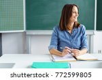 happy smiling female teacher or ...   Shutterstock . vector #772599805