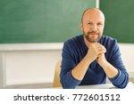 mature man sitting relaxing in... | Shutterstock . vector #772601512