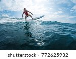 surfer rides the ocean wave.... | Shutterstock . vector #772625932