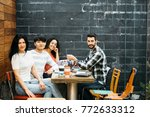 multiethnic group of young... | Shutterstock . vector #772633312