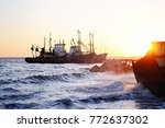 an old ship on the water near... | Shutterstock . vector #772637302