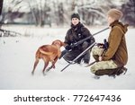 two hunters with rifles in a...   Shutterstock . vector #772647436