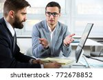 young businessmen discussing... | Shutterstock . vector #772678852