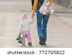 little girl with toy in hands... | Shutterstock . vector #772705822