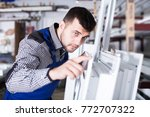 serious adult production worker ... | Shutterstock . vector #772707322