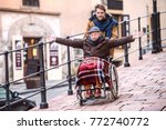 senior father in wheelchair and ... | Shutterstock . vector #772740772