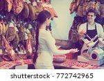 positive brunette choosing... | Shutterstock . vector #772742965