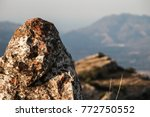 A Rock On The Mountain With Moss