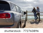 young couple enjoying beach... | Shutterstock . vector #772763896