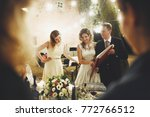 laughing wedding couple stands... | Shutterstock . vector #772766512