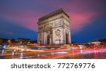 Small photo of Famous Arc de Triomphe at twilight in Paris, France