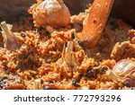 preparation of pilaf on fire.... | Shutterstock . vector #772793296