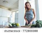 sporty young woman is preparing ... | Shutterstock . vector #772800388