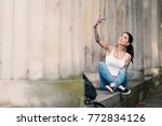young attractive woman taking a ... | Shutterstock . vector #772834126