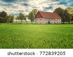 An Old Stone Barn With Wooden...