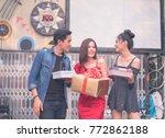 friends making a surprise... | Shutterstock . vector #772862188
