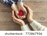 red heart in child and female... | Shutterstock . vector #772867936