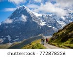 Small photo of Hikers on the The Eiger trail and The Eiger, a 3,967-metre (13,015 ft) mountain of the Bernese Alps, overlooking Grindelwald and Lauterbrunnen in the Bernese Oberland of Switzerland