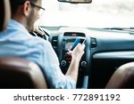 man driver using smart phone on ... | Shutterstock . vector #772891192