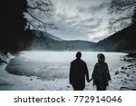 young couple back standing near ... | Shutterstock . vector #772914046