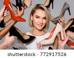 blonde girl and lots of hands... | Shutterstock . vector #772917526