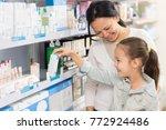 cheerful mature asian woman... | Shutterstock . vector #772924486
