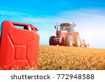 tractor cultivating in the... | Shutterstock . vector #772948588