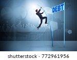 businessman pole vaulting over... | Shutterstock . vector #772961956