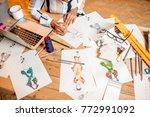 fasion designer sketching... | Shutterstock . vector #772991092
