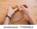 leather craftsman working... | Shutterstock . vector #773000812