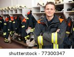 Picture from a young and successful firefighter at work - stock photo