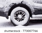 snow on the body and wheels of...   Shutterstock . vector #773007766