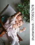 cute little sisters sitting on... | Shutterstock . vector #773017678