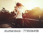 beautiful jogger crossing bridge   Shutterstock . vector #773036458